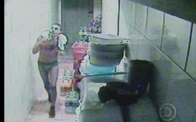Burglar clad only in underwear caught by security cameras robbing a bakery.