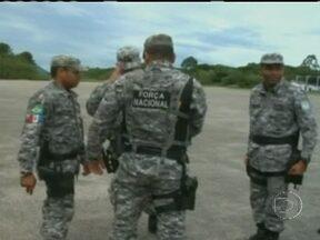 Integrantes da Força Nacional de Segurança chegam a Santa Catarina contra ataques - Os homens da FNS desembarcaram na base aérea de Florianópolis e se preparam para agir. Cerca de 140 policiais estão alojados no centro de tratamento da Polícia Militar.
