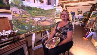 Moradora transforma história de Igarapé em arte - Maria Helena pinta quadros de pontos turísticos da cidade.