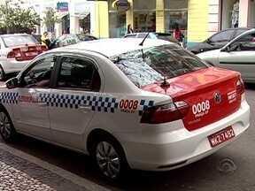 Prefeito de Florianópolis confirma cassação de 76 placas de táxis - Relatório da CPI dos Táxis foi divulgado no fim da tarde desta terça (15).