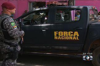 Policiais militares são presos suspeitos de participação em grupo de extermínio, em Goiás - Segundo a Força Nacional, que conduziu a investigação, os policiais são suspeitos de matar traficantes, assaltantes e usuários de drogas em Rio Verde.