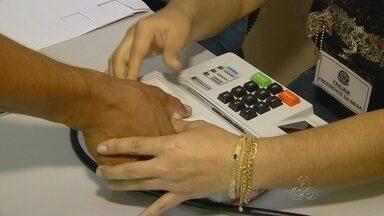 No AM, 186 mil eleitores usam sistema de biometria - Três urnas tiveram problemas; sistema está sendo usado pela primeira vez.