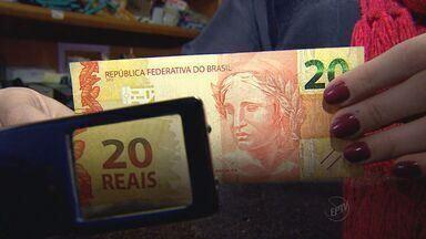 Circulação de notas falsas preocupa comerciantes em Ribeirão Preto, SP - Estado de São Paulo é líder de falsificação de dinheiro no país.