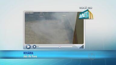 VC no MGTV: Telespectadora registra queimada no pátio da empresa Gil em Juiz de Fora - Ela disse que os funcionários juntam entulho nos fundos do terreno e colocam fogo. Empresa não se pronunciou a respeito.