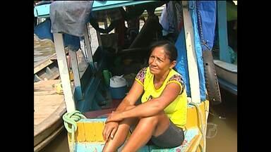 Em Santarém, ribeirinhos viajam de barco para prestigiar N.Sra. da Conceição - Devotos realizam a viagem em pequenas embarcações.