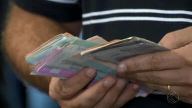 Pesquisa aponta aumento no número de cheques devolvidos em MG - Dados são da Serasa e apontam que total de cheques sem fundo cresceu. Lojistas estudam alternativas.