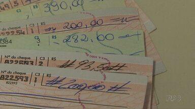 Uso de cheques cai 80% em 20 anos - Uso do cartão de crédito e mais critérios das lojas na hora de aceitar a folhinha estão entre o motivos.