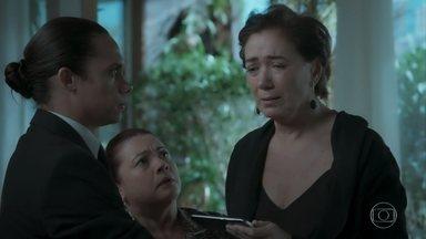 Nonato mostra a Silvana a foto que Eurico recebeu e decide ajudar a arquiteta - A arquiteta se desespera