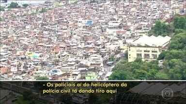 Ação da Polícia Civil deixa PMs sob linha de tiros de UPP - No domingo (14), o helicóptero da Polícia Civil procurava suspeitos pela morte do delegado Fábio Monteiro, assinado sexta-feira (12) quando saiu para almoçar. Os disparos foram ao lado da base da Polícia Militar na favela do Jacarezinho.