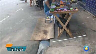 Comerciantes do Centro de Passagem reclamam de mau cheiro - Apesar do problema, comerciantes têm medo de falar.