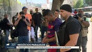 Operação contra milícia prende oito pessoas que atuavam na Baixada Fluminense - Oito pessoas foram presas na Operação Negócios Paralelos, para combater a maior quadrilha de milicianos que atua no estado. Eram 22 mandados de prisão, pelo menos três contra pessoas que estavam na festa em Santa Cruz.