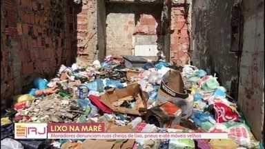 Comunidade RJ mostra lixo acumulado no Complexo da Maré - Moradores pedem a colaboração de quem vive na comunidade colocando o lixo no local certo e comprometimento da Comlurb na coleta do lixo de casa em casa.