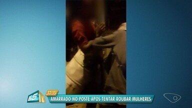 Homem é amarrado em poste após tentar roubar duas mulheres, em Cariacica, ES - Suspeito foi levado para o PA de Alto Lage.