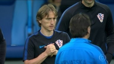 Craques de Croácia e Nigéria tentam brilhar na Copa - Tanto Modric, da Croácia, quanto Obi Mikel, da Nigéria, vão tentar nessa Copa quebrar o estigma de nunca terem feito sucesso num mundial.