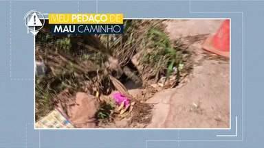 Meu Pedaço de Mau Caminho: Cratera em Arniqueiras preocupa moradores - Via na Quadra 4 apresente buraco e bueiro sem tampa. Administração de Águas Claras promete mandar equipe ao local.