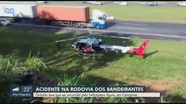 Acidente na Rodovia Bandeirantes deixa gestante ferida; helicóptero Águia fez socorro - Acidente aconteceu em Campinas (SP), no sentido interior. Vítima teve ferimentos leves e foi levada para o Hospital de Clínicas, na Unicamp.