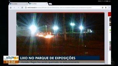 Tô na Rede: lixo no parque de exposições da Fazendinha, no AP - Internauta registra pelo aplicativo da Rede Amazônica, flagrante da queima de lixo no estacionamento do parque