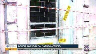 Causa de incêndio que matou quatro pessoas em Porto Alegre não está confirmada - Polícia suspeita de explosão em rede de energia do prédio, que não tinha alvará para funcionar como pensão.