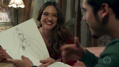 Marocas e Samuca planejam os detalhes para o casamento - Marocas mostra seus desenhos a Samuca