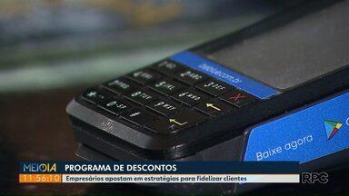 Empresários apostam usam aplicativo de descontos para fidelizar clientes - Programa de descontos usa o celular.