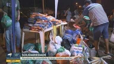 Comunidade do Brejo recebe doações após enchente em Ribeirão Preto - Voluntários entregaram mantimentos e roupas para famílias desabrigadas.