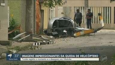 Imagens mostram queda de helicóptero em Ubatuba (SP) - Casal de turistas realizava voo quando piloto perdeu o controle da aeronave. Um morador, que estava em frente à casa em que morava, foi atingido e morreu no local.