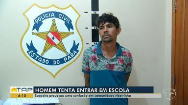 Homem é preso após tentar invadir escola e agredir pessoas na comunidade Costa do Tapará - O caso aconteceu na região ribeirinha de Santarém, na segunda-feira (11). Segundo a polícia, o homem foi até a escola cobrar alunos que lhe deviam dinheiro.