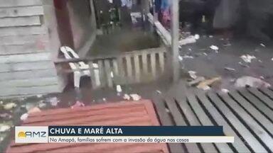 Chuva e maré alta do rio Amazonas invadem casas em Macapá - Famílias sofrem em período chuvoso.