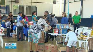 Famílias de venezuelanos que vivem em Sergipe receberam doações na capital - Nos próximos meses, mais estrangeiros do país em crise devem ser acolhidos nosso estado.