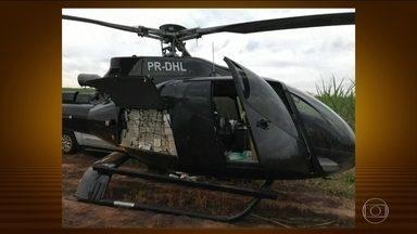 Polícia prende suspeitos de integrar uma quadrilha internacional de tráfico de drogas - Os homens estavam sendo procuradores pela Polícia Federal desde o fim de semana, quando os investigadores apreenderam um helicóptero com meia tonelada de cocaína.