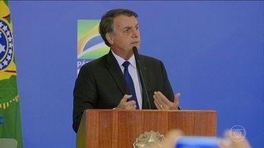 Bolsonaro assina decreto que muda regras para o porte e posse de armas - O decreto permite, por exemplo, a compra de até cinco mil munições por ano para quem tem arma de uso permitido.