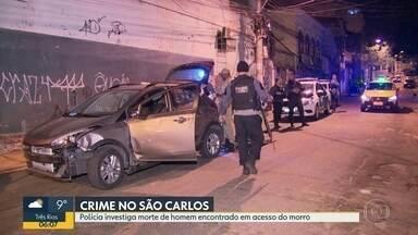 Polícia encontra corpo de homem com sinais de tortura na mala de um carro - Testemunhas dizem que um homem deixou o carro na entrada da favela e fugiu de moto, em um dos acessos do morro de São Carlos. A vítima que ainda não foi identificada, tinha sinais de tortura e estava com as pernas amarradas.