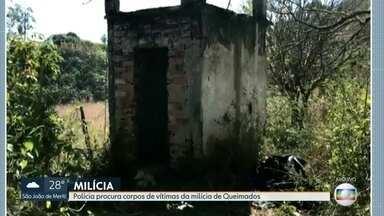 Polícia identifica mais de vinte corpos de vítimas da milícia - Polícia procura outros cemitérios clandestinos da milícia de Queimados