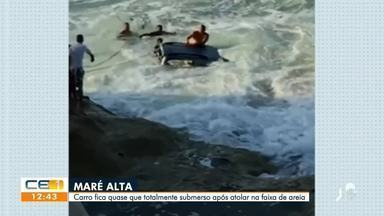 Carro atola na praia e quase é arrastado pelas ondas - Confira mais notícias em g1.globo.com/ce