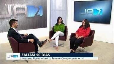 Faltam 50 dias para Matheus Ribeiro e Larissa Pereira estarem na bancada do JN - Apresentadores estarão nas comemorações dos 50 anos do Jornal Nacional. A data é especial também para as gêmeas Suelena e Suelene, que vão fazer 50 anos no mesmo dia em que o casal vai apresentar o JN.