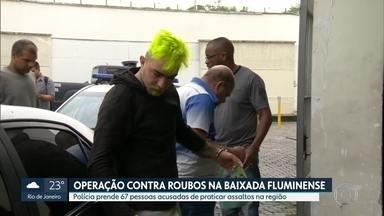 Polícia prende 67 pessoas acusadas de roubos na Baixada Fluminense - Investigadores dizem que assaltantes eram financiados por traficantes, que forneciam armas para os roubos.