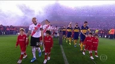 Boca Juniors e River Plate decidem uma vaga na decisão da Libertadores - Maior clássico da Argentina mexe com milhões de torcedores fanáticos..