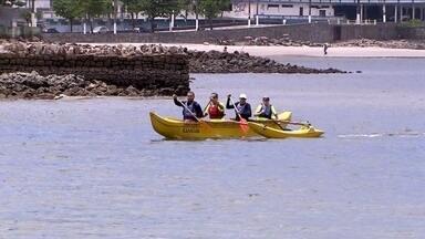 Aquário de Santos e aulas de canoa havaiana atraem turistas neste final de ano - A cidade de São Vicente também tem aulas do esporte que demanda disposição e espírito de equipe.
