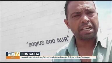 Em Contagem, morador mostra situação da Rua dos Suíços no bairro Flamengo - Esgoto está a céu aberto, mau cheiro está incomodando desde o último temporal.