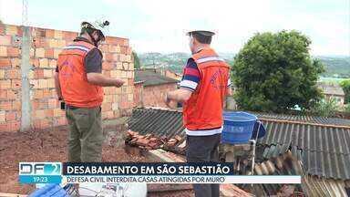 Desabamento em São Sebastião - Defesa Civil interdita casas atingidas por muro construído de forma irregular.