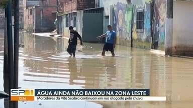 Moradores da Vila Seabra ainda enfrentam rua alagada pela chuva - O risco de chuva forte para os próximos dias já está tirando o sono dos moradores da Zona Leste da capital.