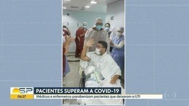 Pacientes superam a Covid-19 - Médicos e enfermeiros parabenizam pacientes que deixaram a UTI.