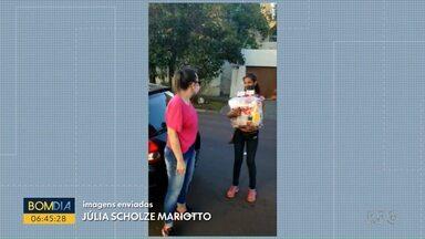 Voluntários entregam roupa e comida a moradores da Vila Torres - Ação reúne amigos que ajudam entre dez e 30 famílias com doações.