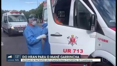 Mané Garrincha recebe dezenas de pacientes - 30 pacientes com covid-19 foram transferidos do Hran para o hospital de campanha nessa quinta (11).