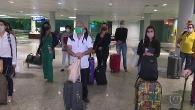 """Voluntários do programa """"O Brasil conta comigo"""" dizem que não receberam salários - Ministério da Saúde afirma que vai quitar os salários atrasados no primeiro dia útil de julho."""