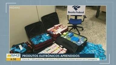 Malas com produtos eletrônicos são apreendidas no aeroporto de Manaus - Cerca de 1200 pendrives, 200 celulares e 220 placas de celulares estavam com 2 passageiros.