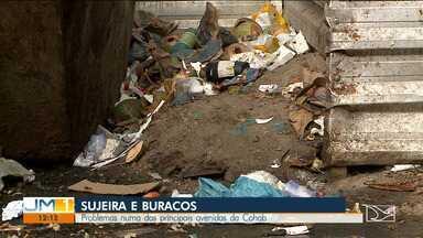 Buracos e sujeira incomodam moradores e comerciantes na Cohab - Os problemas estão presentes em uma das principais avenidas do bairro.