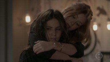 Eliza tenta levantar o astral de Jojô - Jojô não se anima e segue tocando sua guitarra