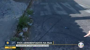 Moradores de Contagem reclamam que fluxo de caminhões e carretas prejudica fiação - Quando passam pelas ruas do bairro Nossa Senhora de Fátima, os veículos mais altos acabam arrebentando os fios.