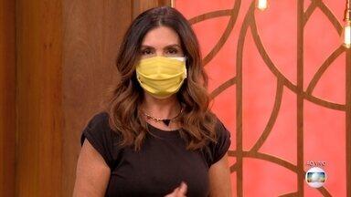 Fátima Bernardes mostra rigor no uso da máscara no estúdio do 'Encontro' - Procedimento preconizado atualmente é o uso de uma máscara cirúrgica descartável sob a máscara de pano